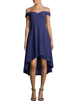 """Image of Off-the-shoulder high-low dress with ruffled hem. Sweetheart neckline. Sleeveless. Concealed back zip. Hi-lo hem. Lined. About 41"""" from top to hem. Polyester/spandex. Dry clean. Imported. Model shown is 5'10"""" (177cm) wearing US size 4."""