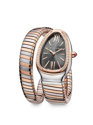 "Image of From the Serpenti Collection. Coiled watch with rose gold accents and diamond bezel. Quartz movement. Water resistant to 3 ATM. Curved stainlesssteel case, 35mm (1.4"").18K rose gold bezel with diamonds, 0.29 tcw. Grey lacquer dial with guilloche border. R"
