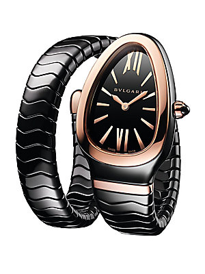 """Image of Black spiral watch with 18K rose gold elements Quartz movement Water-resistant to 3 ATM Curved black ceramic case, 35mm (1.38"""") 18K rose gold bezel Black lacquered polished dial 18K rose gold crown with cabochon-cut ceramic element Roman numeral and bar h"""