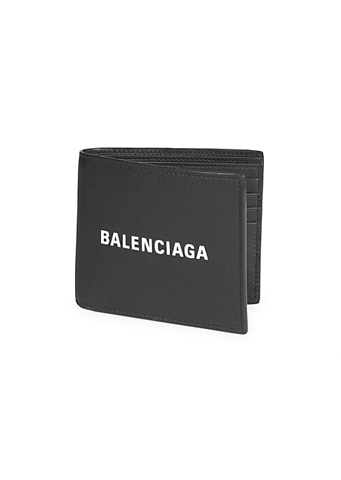 "Image of Leather bi-fold wallet with logo detail. Two bill compartments. Eight credit card slots. 4.5""W x 4""H. Leather. Made in Italy."