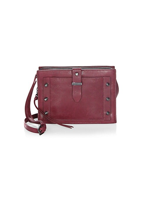 "Image of A sleek and versatile crossbody bag in smooth leather. Adjustable crossbody strap, 25"" drop. Magnetic snap closure. Two snap compartments. One zip-around compartment. One inside zip pocket. Two inside card slots. Gunmetal-tone metal hardware. Lined.10""W x"
