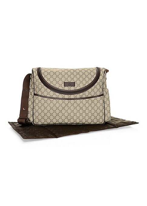 """Image of A signature shoulder bag featuring durable GG canvas. Adjustable strap, 17"""" drop. Inside slip pocket. Lining: Nylon.15""""W x13""""H x 6.5""""D.GG canvas. Trim: Leather. Made in Italy."""