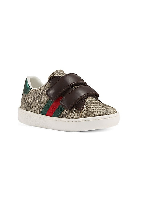 Image of Beige/ebony GG Supreme canvas, a material with low environmental impact. Adjustable grip-tape straps. Brown leather trim. Green and red Web. Red metallic leather detail on the back of one shoe. Green metallic leather detail on the back of the other shoe.