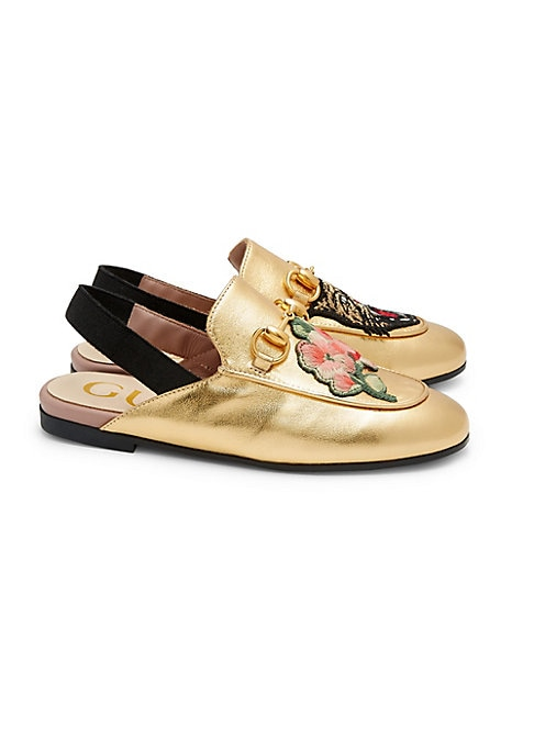 Image of Gold metallic leather upper. Elasticized slingback strap. Embroidered flowers applique on right shoe. Embroidered feline head applique on left shoe. Goldtone horsebit detial. Rubber sole. Made in Italy.