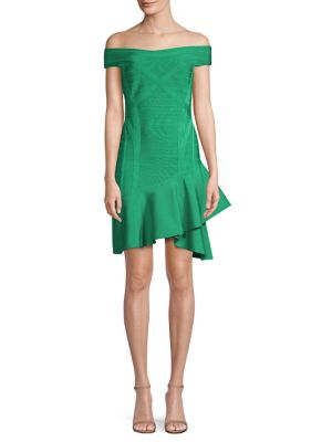 "Image of Bandage dress with asymmetrical ruffled hem. Off-the-shoulder neckline. Cap sleeves. Concealed back zip. About 35"" from shoulder to hem. Rayon/nylon/spandex. Dry clean. Imported. Model shown is 5'10"" (177cm) wearing size Small."