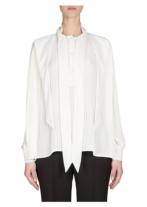 """Image of Pleated tie front blouse in button front style. Crewneck with tie detail. Long sleeves. Button front. About 25"""" from shoulder to hem. Polyester. Dry clean. Made in Italy. Model shown is 5'10"""" (177cm) wearing US size 4."""