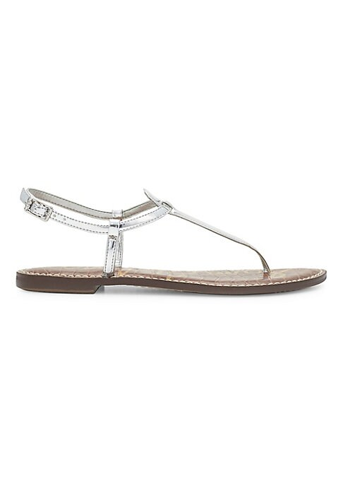 """Image of .Modern, minimalist design doused in shimmer. .Stacked heel, 0.5"""". .Leather upper. .Adjustable ankle strap. .Imported. ."""