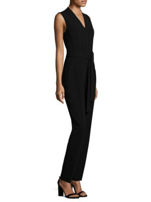 "Image of Crepe sleeveless jumpsuit featuring a belt detail.V-neck. Sleeveless. Concealed back zip. Side slash pockets. Back welt pocket. Cotton trim. Inseam, about 30"".About 58"" from shoulder to hem. Crepe/triacetate/polyester. Machine wash. Imported of Japanese f"