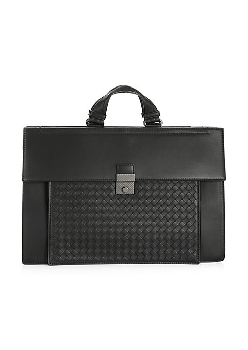 """Image of A luxurious daily companion in intricate woven leather. Double top handles. Snap button closure. One interior zip pocket.17""""L X 11""""H X4""""W.Leather. Professional clean. Made in Italy."""