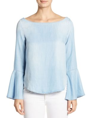 """Image of Chambray-style top framed with on-trend bell sleeves. Boatneck. Long bell sleeves. Shirttail hem. Pullover style. About 27"""" from shoulder to hem. Tencera. Machine wash. Made in USA. Model shown is 5'10"""" (177cm) wearing size Small."""