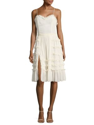 "Image of Sleeveless dress with ruffled design for an elegant look. Sweetheart neckline. Sleeveless. Thigh slit. Lined. About 36"" from shoulder to hem. Polyester. Hand wash. Imported. Model shown is 5'10"" (177cm) wearing size Small."