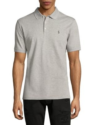 Image of This Classic Fit Polo shirt is infused with extra stretch for a great fit-and an even greater ease of movement. Polo collar. Short sleeves. Three-button placket. Rib-knit neck and cuffs. Signature logo embroidered at chest. Tennis tail. Cotton. Machine wa