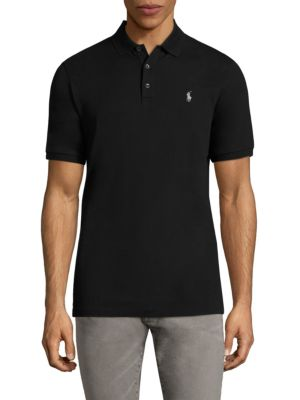 Image of This Classic Fit Polo shirt is infused with extra stretch for a great fit-and an even greater ease of movement. Polo collar. Short sleeves. Three-button placket. Rib-knit neck and cuffs. Signature logo embroidered on chest. Tennis tail. Cotton. Machine wa