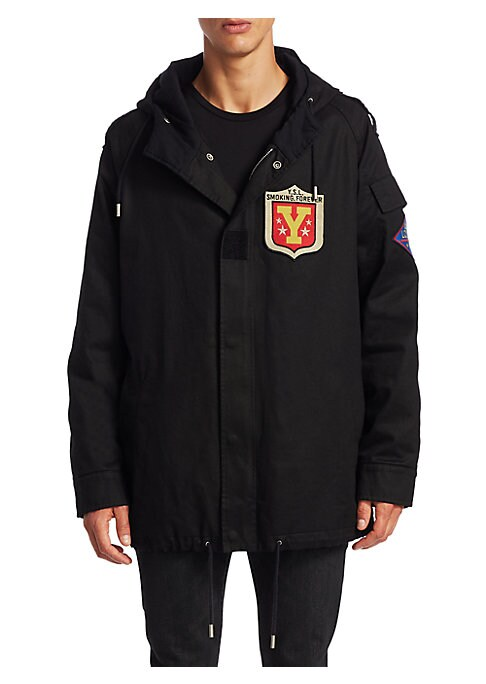 """Image of Cotton-blend hooded parka featuring patch details. Attached hood. Epaulettes. Long raglan sleeves with flap pocket. Snap cuffs. Concealed front snap with snap button closure. Side welt pockets. Adjustable drawstring hem. Regular-fit. Lined. About 30"""" from"""