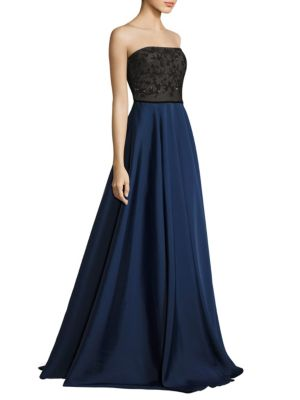 "Image of Two-toned strapless gown with floral details. Straight across neckline. Concealed back zip. Self-tie at back. Lined. About 62"" from top to hem. Polyester. Dry clean. Imported. Model shown is 5'10"" (177cm) wearing US size 4."