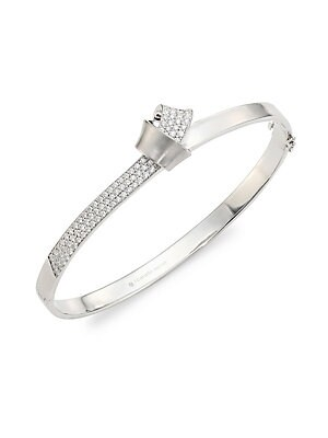 Image of From the Knot Collection. A fold of sumptuous brushed white gold intertwines with another lined in three rows of brilliant pavé diamond, encircling the wrist to form a knot that creates a structured, elegant bangle that gives you around-the-clock glamour.