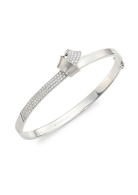 Image of A fold of sumptuous brushed white gold intertwines with another lined in 3 rows of brilliant pave diamond, encircling the wrist to form a knot that creates a structured, elegant bangle that gives you around-the-clock glamour. From the Knot Collection. Dia