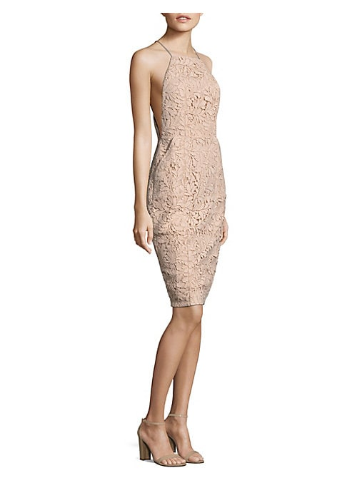 """Image of Midi polyester-blend dress featuring lace pattern and back slit. Halterneck. Sleeveless. Concealed back zip. About 42"""" from shoulder to hem. Polyester/spandex. Hand wash. Imported. Model shown is 5'10"""" (177cm) wearing size Small."""