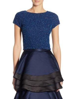 """Image of Elegant cropped top with sequins, bead, and crystal embellishments. Crewneck. Cap sleeves. Exposed back zip. Lined. About 18"""" from shoulder to hem. Nylon/elastane. Dry clean. Imported. Model shown is 5'10"""" (177cm) wearing US size 4."""