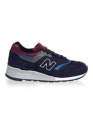 Image of Multi colored lace-up suede sneakers Leather, suede and synthetic upper Almond toe Lace-up vamp Embossed brand name on tongue Brand logo patch on side Rubber sole Made in USA. Men's Shoes - Contemporary Lifestyle. New Balance. Color: Navy. Size: 8.5 D.