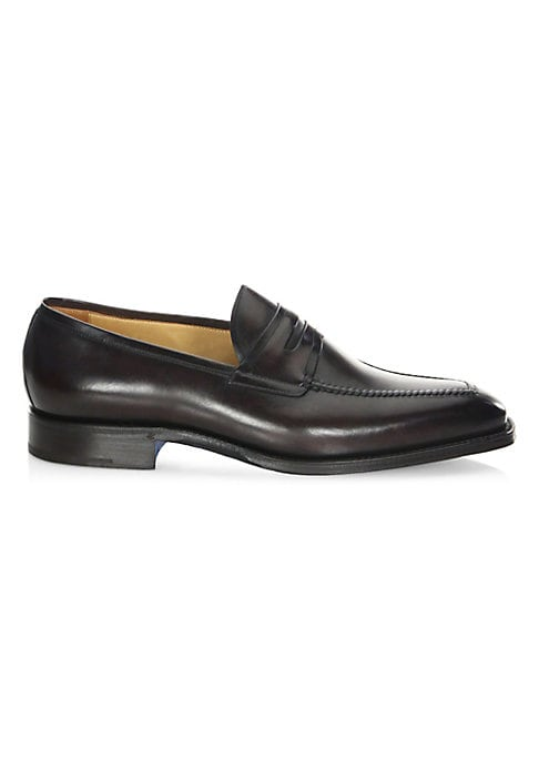 Image of .Almond toe penny loafers crafted in leather fabric. .Leather upper. .Almond toe. .Slip-on style. .Leather lining and sole. .Made in Italy. .