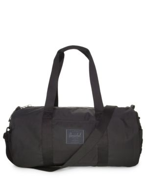 """Image of .Classic nylon duffel bag with spacious storage. .Double top handles. .Removable, adjustable crossbody strap. .Top zip closure. .13.5""""W x 19""""H x 19""""D. .Ballistic nylon. .Imported. ."""