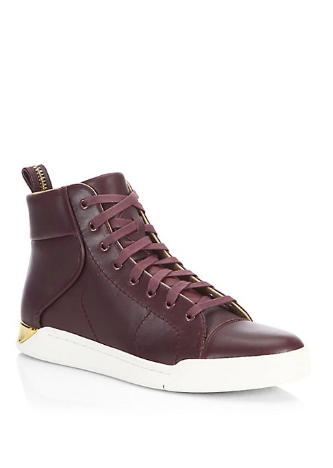 Image of Sleek leather high-top sneakers with gilded hardware. Leather upper. Back pull tab. Lace-up style. Rubber sole. Padded insole. Imported.