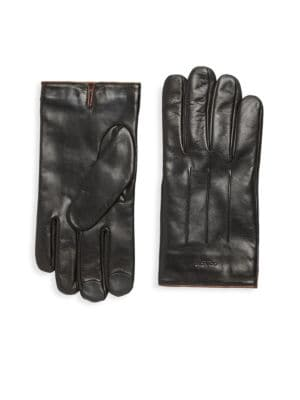 Image of Pair of warm leather gloves with pintuck at top. Nappa leather. Dry clean. Imported.