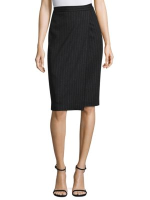 "Image of Classic wool-blend pencil skirt featuring a timeless pinstripe pattern. Banded waist. Concealed back zip. About 30"" long. Virgin wool/cotton. Dry clean. Made in Italy. Model shown is 5'10"" (177cm) wearing US size 4."