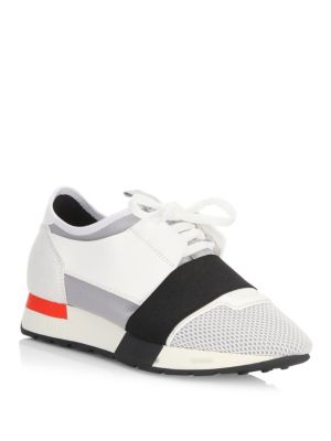 Image of Sneakers with covered shoelace and elastic band. Mesh, leather and neoprene upper. Round toe. Lace-up vamp. Microfiber foam lining. Rubber sole. Made in Italy. Please note: Avoid exposure to rain and humidity.