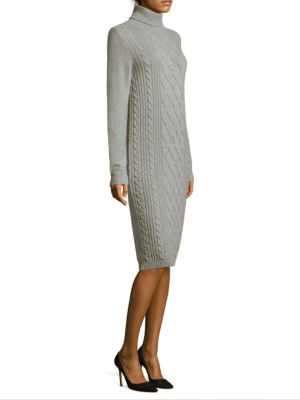 """Image of Wool-blend sweater dress with cable-knit at front. Turtleneck. Long sleeves. Rib-knit cuffs and hem. About 39"""" from shoulder to hem. Wool/silk/cashmere. Dry clean. Made in Italy. Model shown is 5'10"""" (177cm) wearing US size 4."""