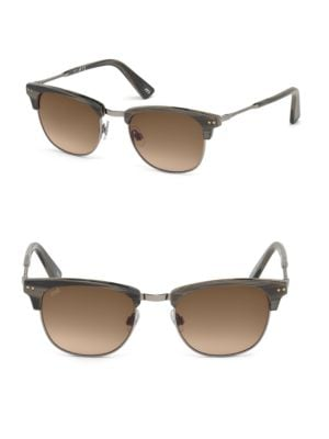 Image of Metal temple brings attention to these sunglasses.20mm lens width; 51mm bridge width; 140mm temple length.100% UV protection.2-base gradient lens. Adjustable nose pads. Metal/acetate. Made in Italy.