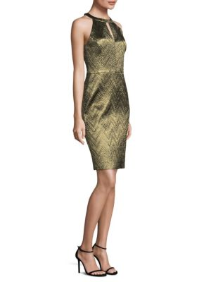 "Image of From the Nights on Broadway Collection. Dress with a burnished zigzag jacquard design. Halterneck. Sleeveless. Concealed back zip. Back slit. About 41"" from shoulder to hem. Polyester/polyamide/metallized fiber. Dry clean. Made in USA of imported fabric."