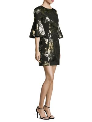 "Image of From the Nights on Broadway Collection. Casual dress featuring a metallic floral design. Bell sleeves.V-back. Concealed back zip. About 36"" from shoulder to hem. Polyester. Dry clean. Made in USA of imported fabric. Model shown is 5'10"" (177cm) wearing US"