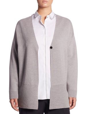 """Image of Wool cardigan with ribbed cuffs and hem details.V-neck. Long sleeves. Button front. About 28"""" from shoulder to hem. Virgin wool. Hand wash. Imported."""