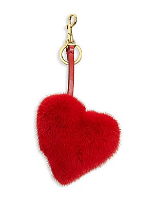 """Image of Elegant fur heart charm with a leather strap Lobster clasp Length, 4"""" Fur type: Dyed mink Fur origin: Denmark Leather Made in Italy. Handbags - Advanced Designer Handba > Saks Fifth Avenue. Anya Hindmarch. Color: Bright Red."""