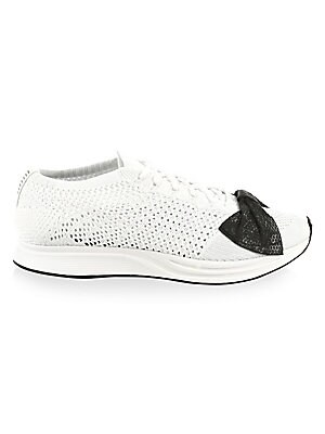 Image of Breathable sneakers with bow detail on toe Mesh knit upper Round toe Lace-up vamp Rubber sole Imported. Women's Shoes - Designer Womens Shoes > Saks Fifth Avenue. Comme des Garcons. Color: White. Size: 36 (4).