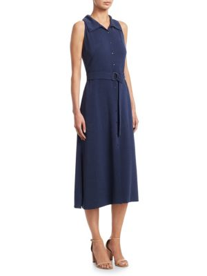 """Image of .Casual sleeveless midi dress with side slits. Buttoned spread collar. Sleeveless. Front snap button closure. Attached belted waist. Waist slip pockets. About 48"""" from shoulder to hem. Viscose/acetate. Dry clean. Imported. Model shown is 5'10"""" (177cm) wea"""