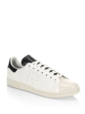 Image of Classic sneakers with perforated detail. Leather upper. Round toe. Lace-up vamp. Leather lining. Rubber sole. Imported.