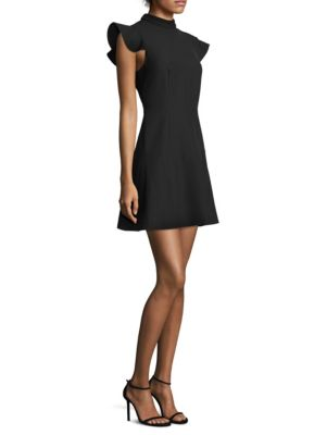 """Image of Twill silhouette designed with ruffled sleeves. High neck. Cap sleeves. Exposed back zip. Flared hem. Polyester/viscose/elastane. Dry clean. Imported. Model shown is 5'10"""" (177cm) wearing US size 4."""