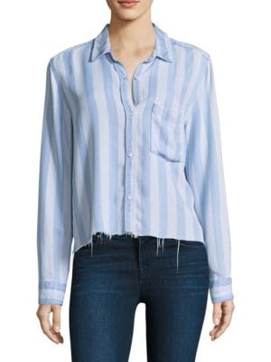 """Image of Button-down shirt with a distressed hem. Point collar. Long sleeves. Buttoned barrel cuffs. Button front. Chest patch pocket. About 22"""" from shoulder to hem. Tencel. Machine wash. Imported. Model shown is 5'10"""" (177cm) wearing size Small."""