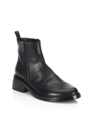 """Image of Sleek leather ankle boot framed with zip sides. Self-covered block heel, 2"""" (50mm).Leather upper. Round toe. Side zip closure. Leather lining and sole. Made in Italy."""