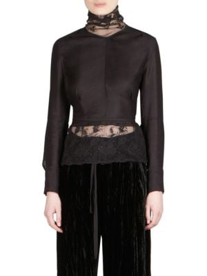 """Image of Wool turtleneck top with floral lace detailing. Turtleneck. Long sleeves. Ribbon detail. Back button closure. About 25"""" from shoulder to hem. Virgin wool/linen/cotton. Dry clean. Made in Italy. Model shown is 5'10"""" (177cm) wearing US size 4."""