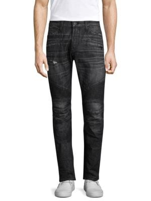 """Image of Skinny fit jean with moto detail at knee and light destruction. Skinny fit. Rise, about 10"""".Leg opening, about 13"""".Inseam, about 34"""".Cotton/elastane. Machine wash. Imported."""