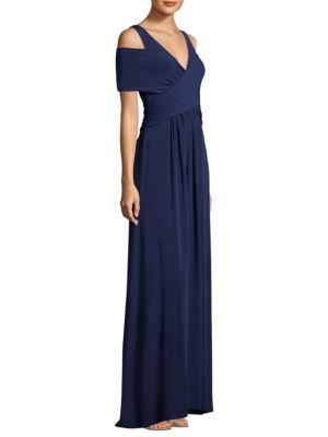 "Image of A-line jersey gown with front wrap.V-neck. Cold-shoulders. Short sleeves. Concealed back zip with hook-and-eye closure. Lined. About 60"" from shoulder to hem. Acetate/nylon/spandex matte jersey. Hand wash. Imported. Model shown is 5'10"" (177cm) wearing si"