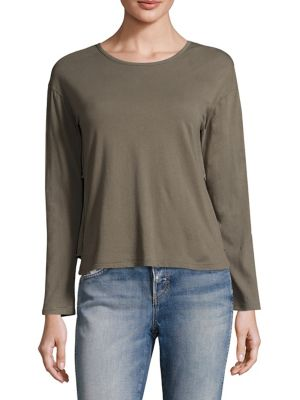 """Image of Cotton tee featuring tiered ruffle detail at back. Roundneck. Long sleeves. About 21"""" from shoulder to hem. Cotton. Machine wash. Made in USA. Model shown is 5'10"""" (177cm) wearing size Small."""