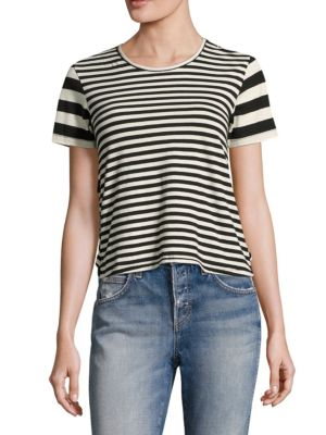 """Image of Relaxed striped tee uplifted with back ruffled tiers. Roundneck. Short sleeves. Pullover style. Hi-lo hem. About 21"""" from shoulder to hem. Cotton/polyester. Machine wash. Made in USA. Model shown is 5'10"""" (177cm) wearing size Small."""