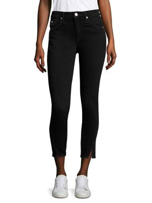 """Image of High-rise skinny jeans with split twisted hem. Belt loops. Zip fly with button closure. Five-pocket style. Rise, about 9.25"""".Inseam, about 28"""".Leg opening, about 9"""".Cotton/polyester. Machine wash. Imported. Model shown is 5'10"""" (177cm) wearing size Small."""