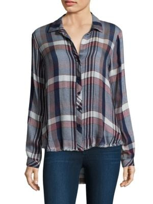 """Image of Casual button-down shirt with frayed trim at hem featuring plaid design. Spread collar. Long sleeves. Buttoned barrel cuffs. Button front. Curved hi-lo hem. About 27"""" from shoulder to hem. Rayon. Machine wash. Made in USA. Model shown is 5'10"""" (177cm) wea"""