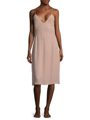 Image of Eye-catching silk knee-length dress with pleated details.V-neck. Sleeveless. Spaghetti straps. Scoopback. Pintuck pleats at seamed waist. Silk. Hand wash. Made in USA.